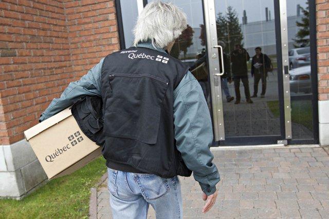 Les neuf perquisitions menées mercredi par des agents... (Photo: Patrick Sanfaçon, La Presse)