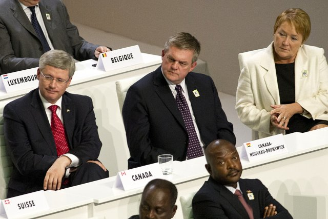 Le premier ministre du Canada Stephen Harper et... (Photo: PC)
