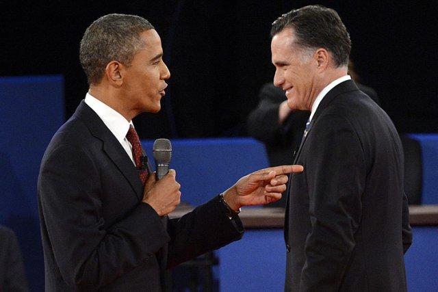 Barack Obama et Mitt Romney lors de leur... (Photo: AFP)