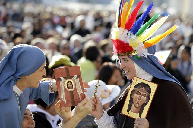 Au moins 1500 pèlerins canadiens, dans leur grande... (Photo: AP)