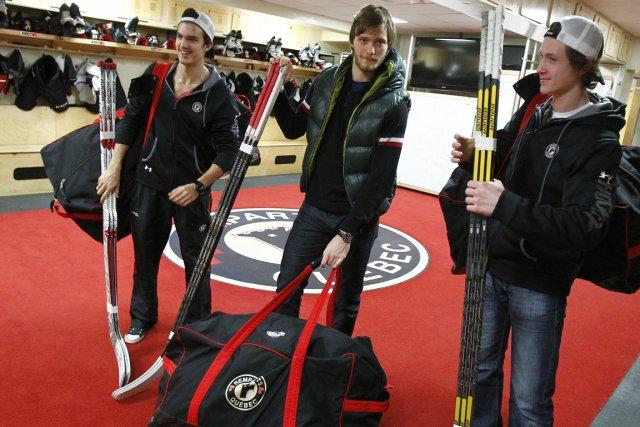 Trois joueurs des Remparts de Québec se préparaient... (Photo: Le Soleil)