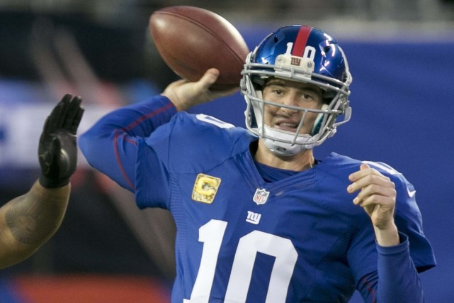 Le quart-arrière des Giants de New York Eli... (Photo Ray Stubblebine, archives Reuters)
