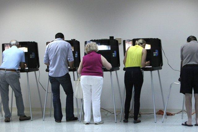 Des électeurs à Miami.... (Photo AP)