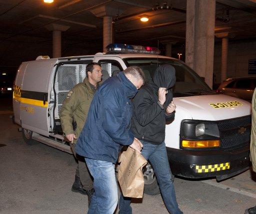 Quatorze personnes arrêtées hier demeureront derrière les barreaux au moins... (Imacom, Claude Poulin)