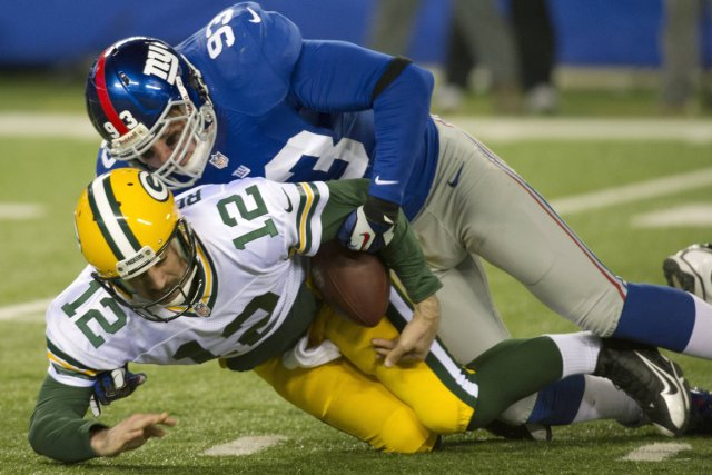 Aaron Rodgers (12) et les Packers se sont... (Photo: Reuters)