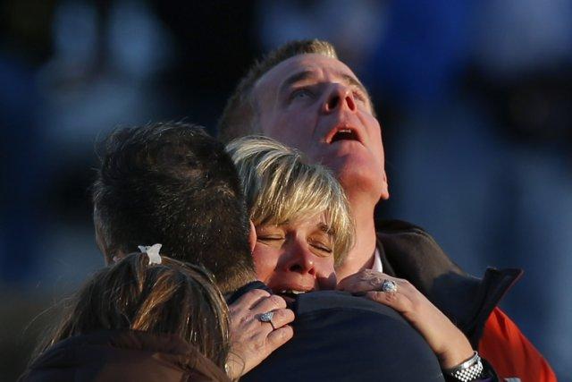 La famille d'une victime du carnage près de...