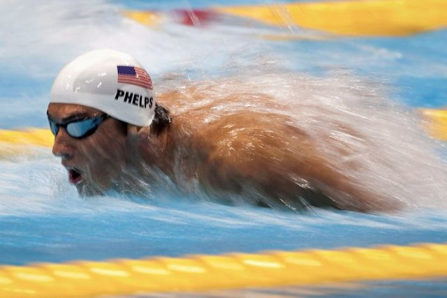 Michael Phelps of the USA explodes out of... (Frank Gunn)