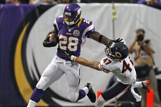 Adrian Peterson, des Vikings, conserve une moyenne spectaculaire... (Photo : Eric Miller, Reuters)