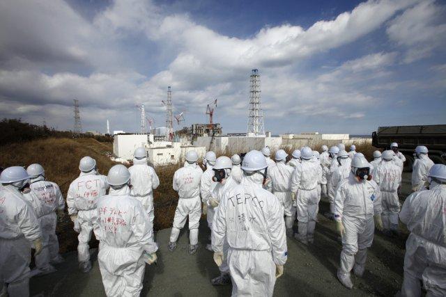 Des représentants des médias, équipés, à proximité de... (Photo Reuters)
