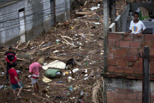 Les dégâts liés à la forte pluie sont... (Photo: Felipe Dana, Associated Press)