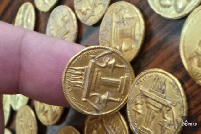 Les pièces sont à l'effigie d'un roi ou... (Photo : Ali Al-Alak, AFP)