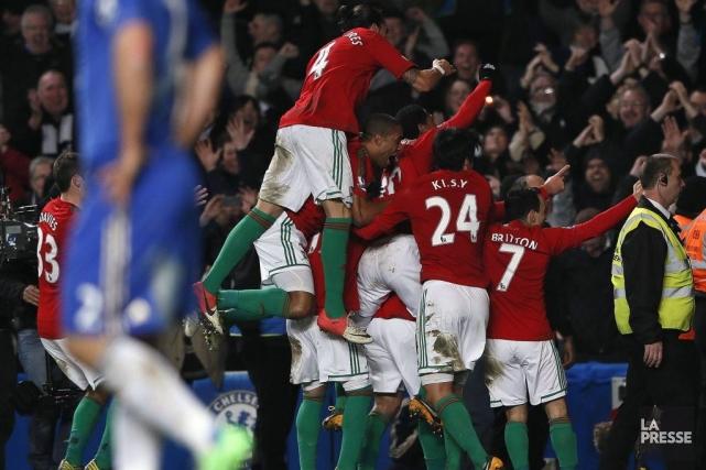 Les joueurs de Swansea célèbre leur victoire.... (Photo Stefan Wermuth, Reuters)