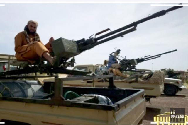 Des combattants d'Al-Qaïda au Maghreb islamique (AQMI), prêts... (Photo AFP)