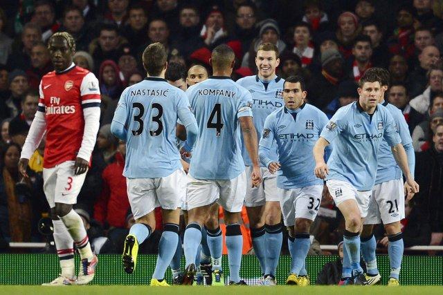 Cette victoire de 2-0 contre Arsenal ramène Manchester... (Photo : Adrian Dennism AFP)
