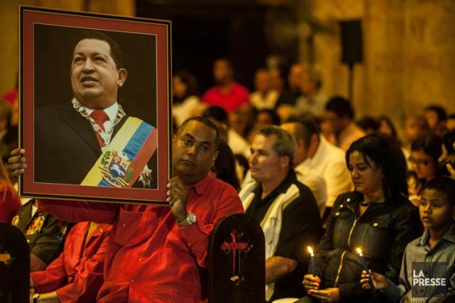 Des partisans de Hugo Chavez ont prié pour... (Photo: AFP)