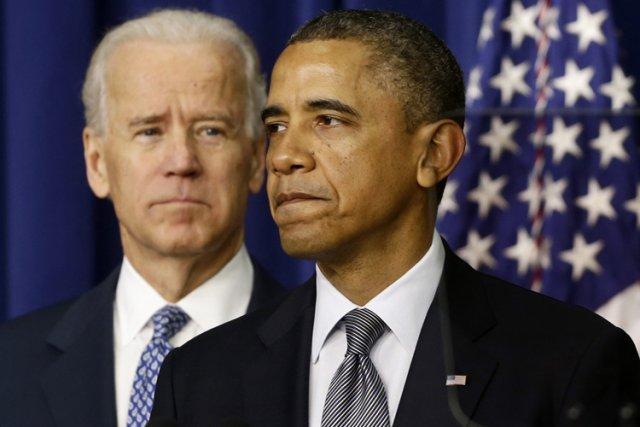 Barack Obama était flanqué de Joe Biden lors... (Photo: AP)