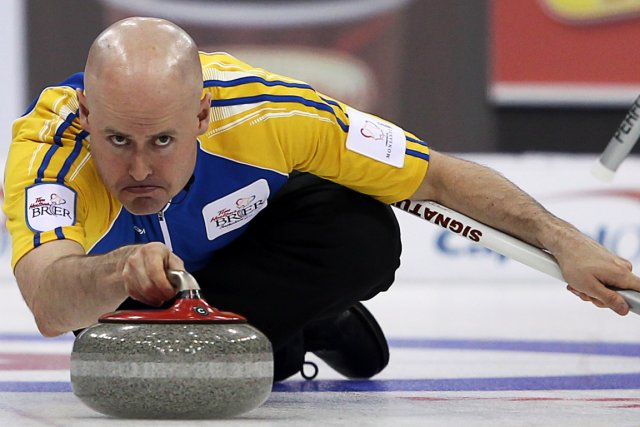 Kevin Koe, le champion en titre.... (Photo : Jonathan Hayward, archives PC)