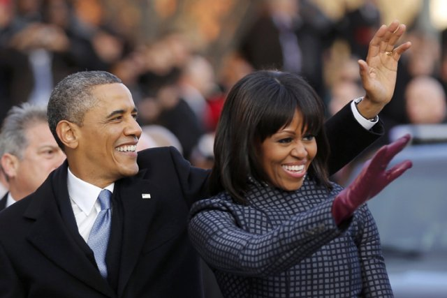 Barack Obama et sa femme Michelle ont salué... (Photo: Reuters)