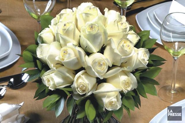 Il faut réserver les arrangements floraux de trois... (Photo : archives AP)