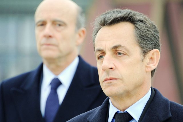 Nicolas Sarkozy et Alain Juppé (en second plan),... (PHOTO ERIC FEFERBERG, ARCHIVES AFP)