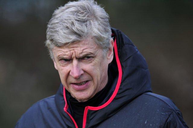 Arsène Wenger a réagi avec colère à un... (Photo Glyn Kirk, AFP)