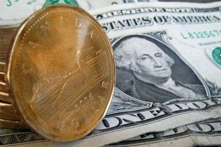Le dollar canadien s'échangeait à 95,16 cents US.... (Photo: Paul Chiasson, archives PC)