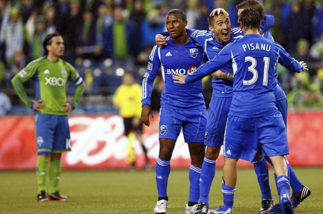 Patrice Bernier, Davy Arnaud, Jeb Brovsky et Andrea... (Photo Associated Press)