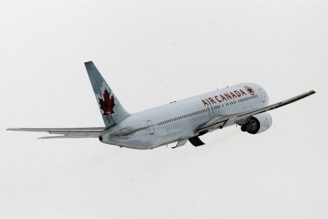 Bonne nouvelle pour les grands voyageurs: prendre l'avion aura rarement... (PHOTO MARTIN CHAMBERLAND, LA PRESSE)