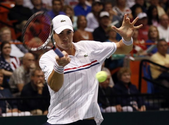 John Isner affrontera en demi-finales le champion en... (Photo Jim Urquhart, Reuters)
