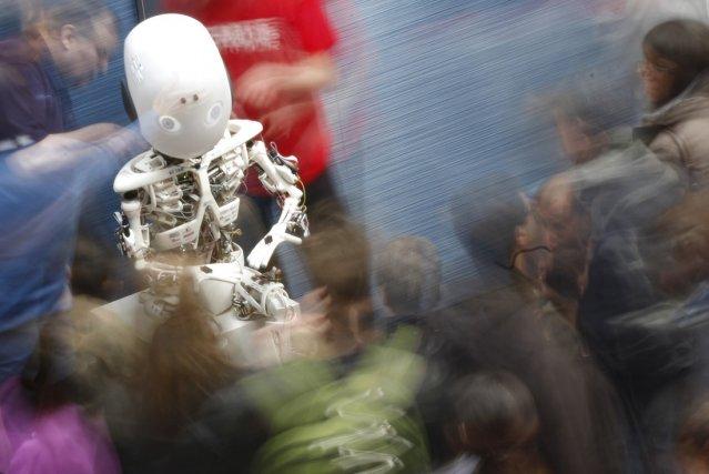 Un robot présenté lors d'une exposition consacrée à... (Photo Michael Buholzer, Reuters)