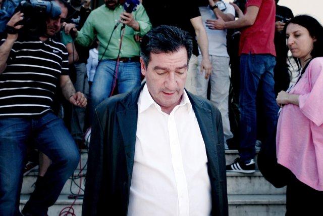 Le maire d'Athènes Georges Kaminis (ci-dessus) a été... (PHOTO ANGELOS TZORTZINIS, AFP)