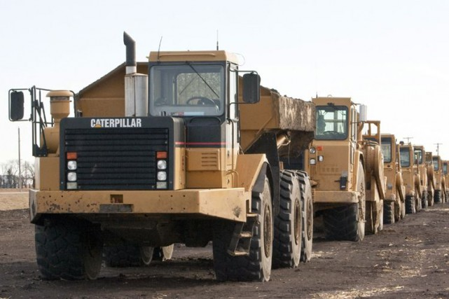 L'action de Caterpillar progressait jeudi en raison des... (PHOTO AP)