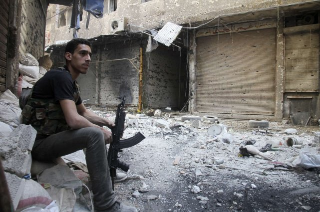Un rebelle près deYarmouk.... (Photo archives Reuters)