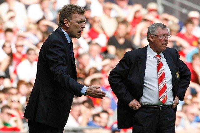 David Moyes (à gauche) succédera à Alex ... (Photo Ian Kington, archives AFP)