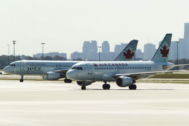Des avions d'Air Canada à l'aéroport Pearson, de... (Photo archives La Presse Canadienne)