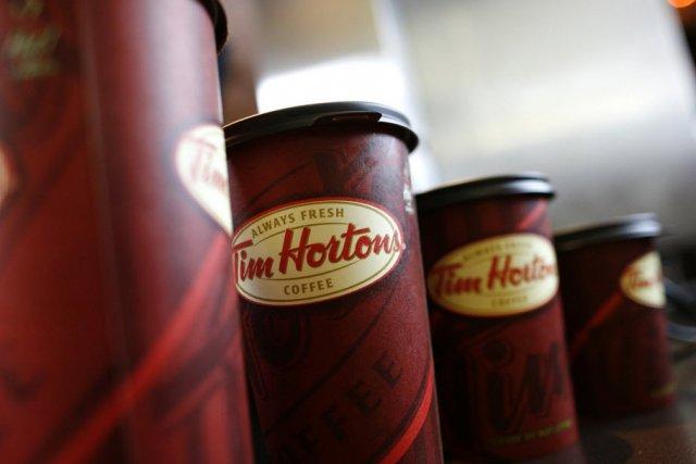 Tim Hortons (T.THI) a annoncé mardi avoir accepté de racheter,...
