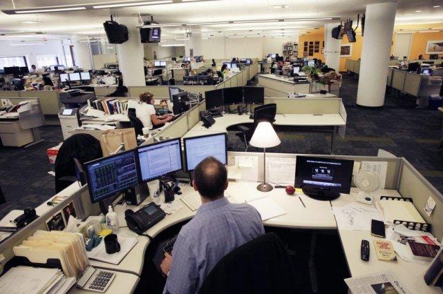 La salle de rédaction du siège social de... (Mark Lennihan)