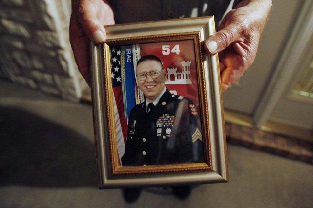 Portrait dusergent John Russell,reconnu coupable du meurtre avec... (Photo JESSICA RINALDI, REUTERS)