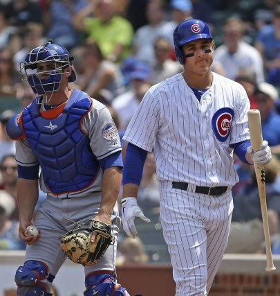 Anthony Recker et Anthony Rizzo lors du match... (Photo Charles Cherney, AP)