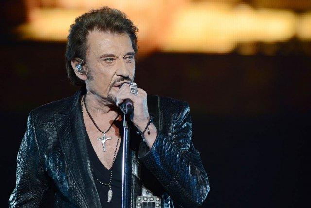 La nouvelle tournée de Johnny Hallyday s'intitule Born... (PHOTO NATALIA KOLESNIKOVA, AFP)