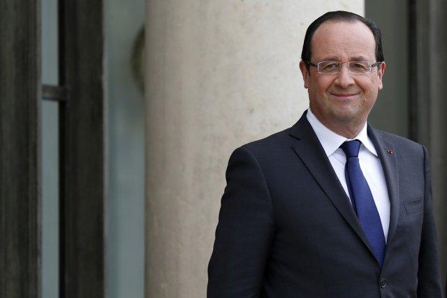 Le président François Hollande a fait part dimanche de sa «vive émotion» et... (PHOTO BENOIT TESSIER, REUTERS)