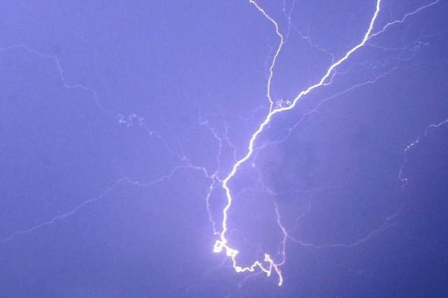 Les prévisions d'orages persistant sur la région de... (PHOTO ARCHIVES AP)