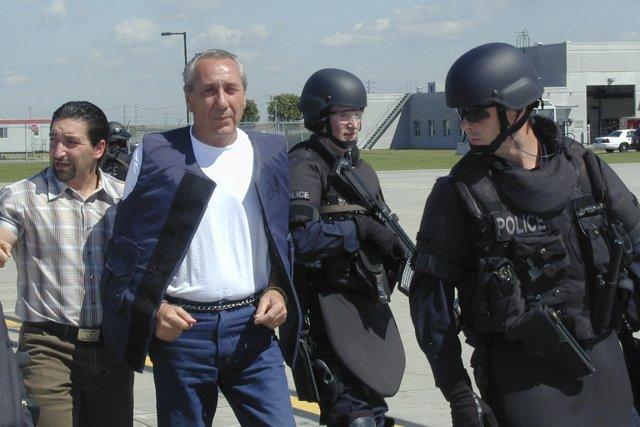 Escorté par des policiers armés jusqu'aux dents, Vito... (Photo Gesca)