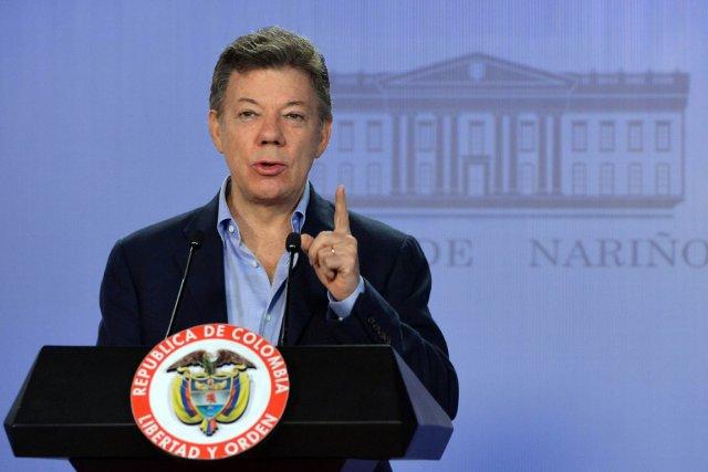Le président colombien Juan Manuel Santos a rectifié... (PHOTO JAVIER CASELLA, AFP)