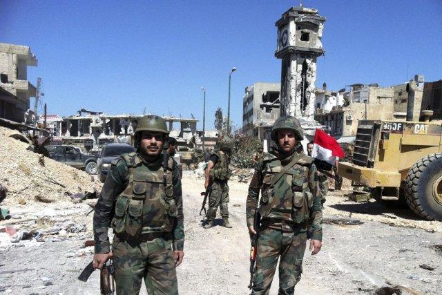 Des soldats du régime Assad dans la province... (Photo AFP)