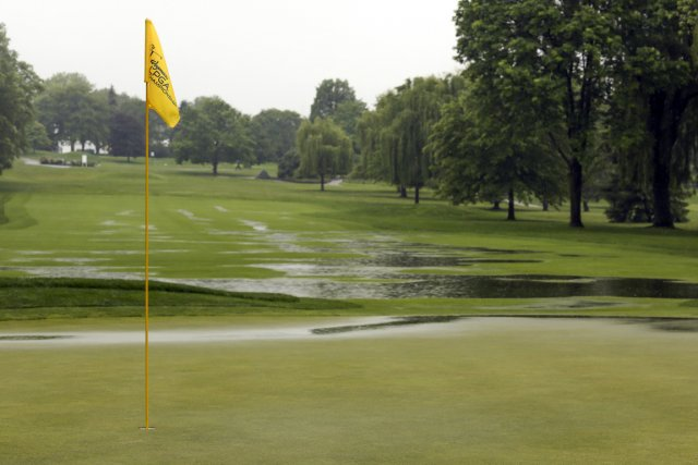 La pluie diluvienne a provoqué le report du premier parcours du Championnat de... (Photo Adam Fenster, Reuters)