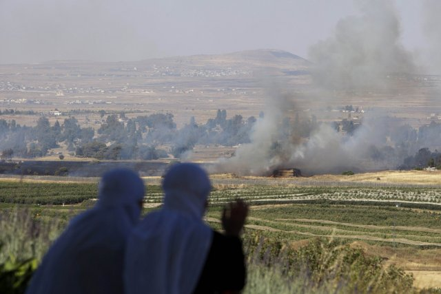 Le plateau du Golan enfumé à la suite... (PHOTO AHMAD GHARABLI, AFP)