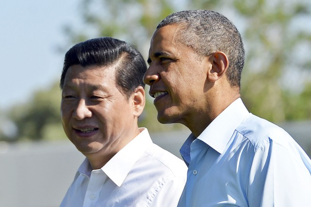 Les présidents américain Barack Obama et chinois Xi... (PHOTO JEWEL SAMAD, archives AFP)
