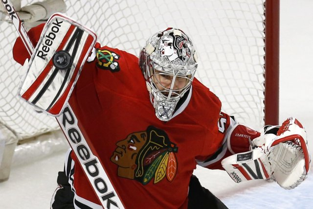 Le gardien des Blackhawks Corey Crawford a une... (Photo Jim Young, Reuters)