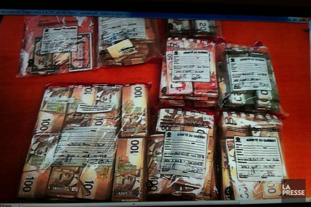 Voici l'argent remis par Me Pierre Lambert à... (Photo: tirée de la vidéo de la CEIC)